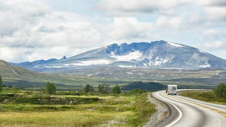 Open road in the Dovre national park, the view of the mountain Snowhetta