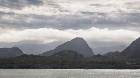 Norwegian coast, the mountains surround Brufjord 写真素材 - 131340088