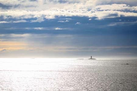 Norwegian coastline, lighthouse in the Norwegian sea at the sunset Stockfoto