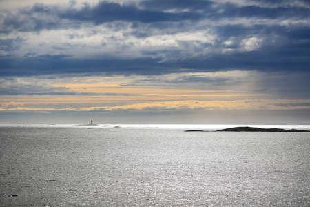 Norwegian coast, lighthouse in the Norwegian sea near Sandviksberget