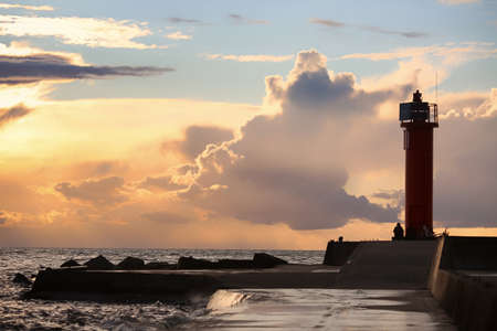 Mangalsala lighthouse located in Rigas bay in the Latvian capital Riga during colorful summer sunset