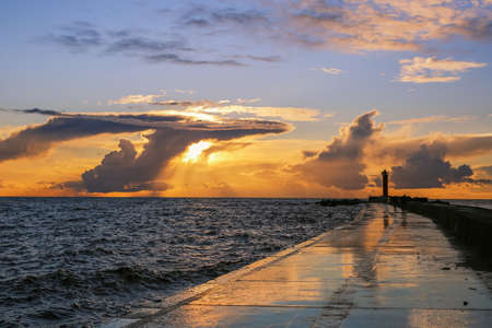 mangalsala lighthouse located in the Latvian capital Riga in the Rigas bay during colorful summer sunset