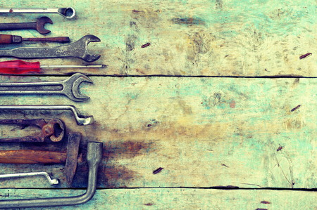 Mechanic tools set on a wooden background