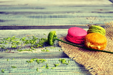 Colorful macaroons on a wooden table photo