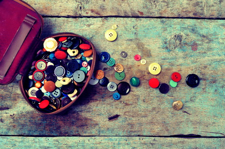 group objects: Old buttons on a wooden background