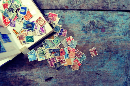 Old post stamps on a wooden background