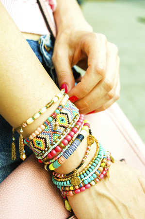 Stylish bracelets on female hand