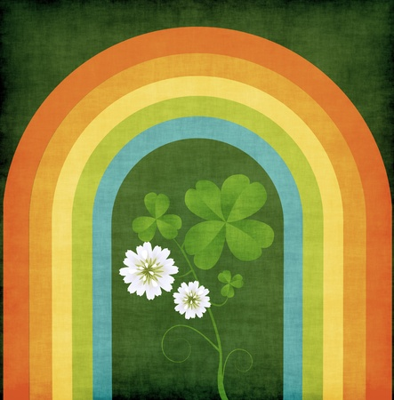 Grunge background with four leaves clover and rainbow photo