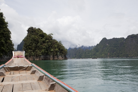 Travel with boat in Ratchaprapa dam lakeside ,Thailand photo