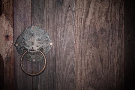 Old knocker design on the door background Stock Photo - 14790426