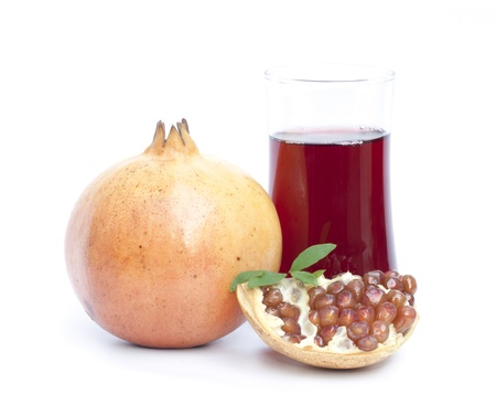 Pomegranate fruit and juice isolated on the white background photo