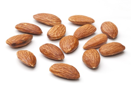 Almond nuts isolated on the white background photo