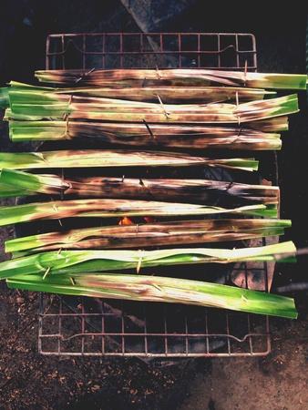 grill: Thai sweet food ,coconut in Palm leaf grill