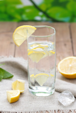 lemon water: Cold Water with Lemon Stock Photo