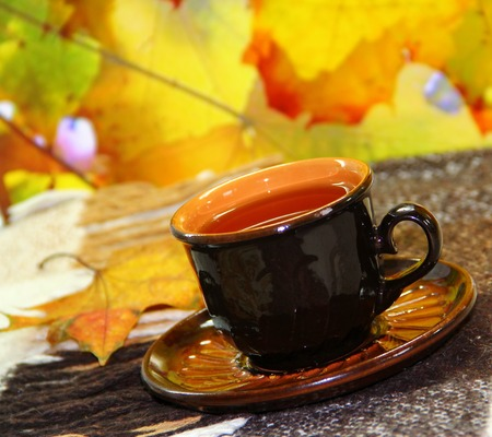 cosiness: ?up of tea and autumn leaves Stock Photo