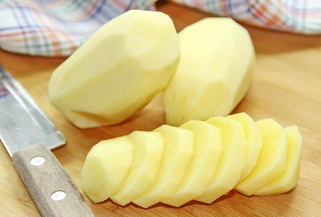 raw potato: Raw potato on the wooden table Stock Photo