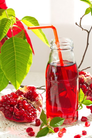 Ripe Red Pomegranates and Fresh Juice photo