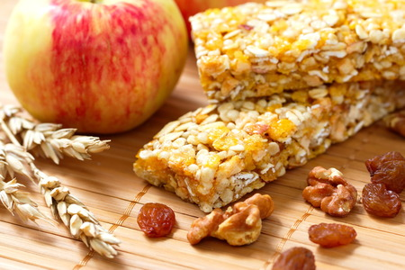 Cereal bars of granola with apples, nuts and raisins
