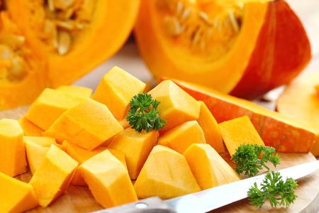 sweet segments: Pumpkin on the wooden table Stock Photo