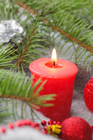new year eve beads: Red candle with christmas decoration