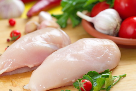 Raw chicken fillet with vegetables prepared for cooking