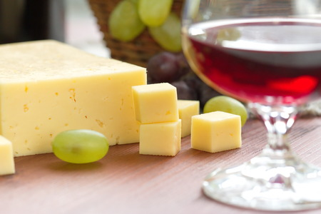 white cheese: Cheese, grape and red wine