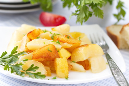 plates of food: Roast potatoes with fresh herbs Stock Photo