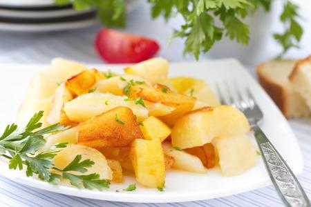 mediterranean food: Roast potatoes with fresh herbs Stock Photo