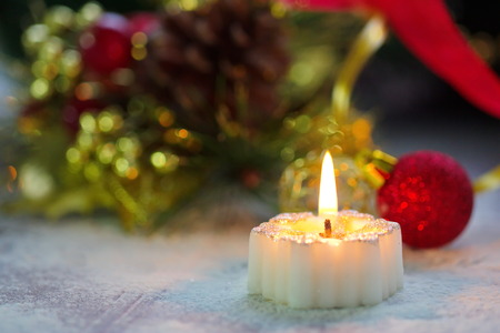 new year eve beads: Burning candle with christmas decoration