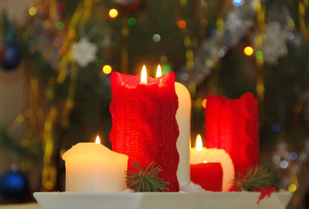 new year eve beads: Burning candles at a Christmas night Stock Photo