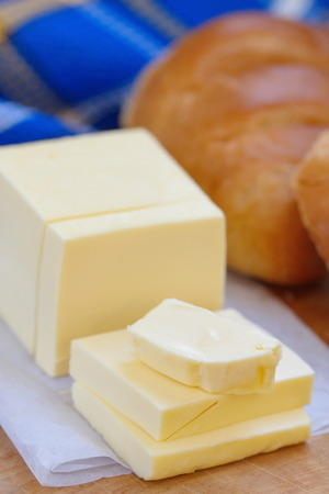 butterfat: Fresh sliced butter on the wooden table