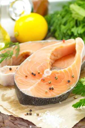 japanese cookery: Raw fish with vegetables, lemon, spices and oil prepared for cooking