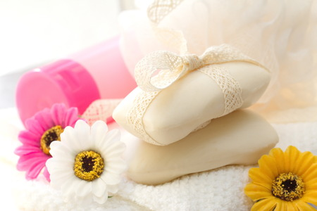 salon background: Gentle flower soap and SPA accessories Stock Photo