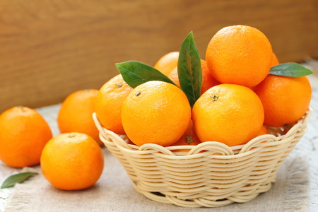 fruit juices: Fresh tangerines in a basket