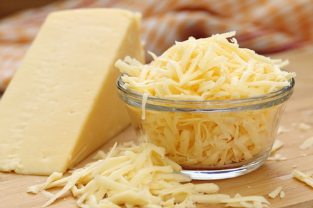 Grated cheese in a glass bowl