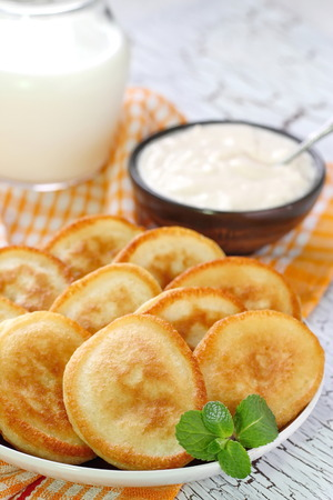 sour cream: Pancakes with sour cream for breakfast Stock Photo