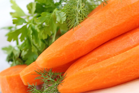 the greens: Fresh carrot with greens prepared for cooking Stock Photo