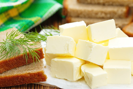 butterfat: Fresh butter and bread on the table
