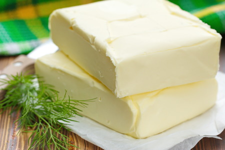 butterfat: Fresh butter on the wooden table