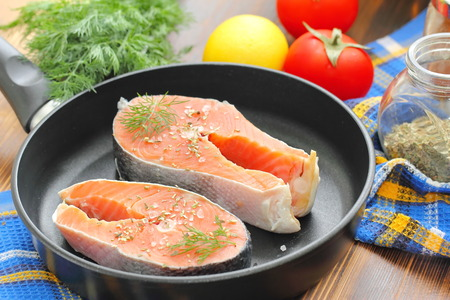 recipe background: Raw fish in pan prepared for frying Stock Photo