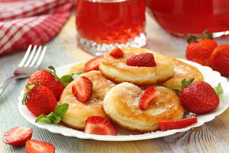 dairy product: Homemade pancakes with sugar powder and fresh strawberry Stock Photo
