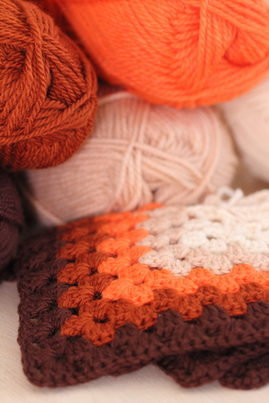 crocheted: Color balls of wool and crocheted Granny Squares Stock Photo