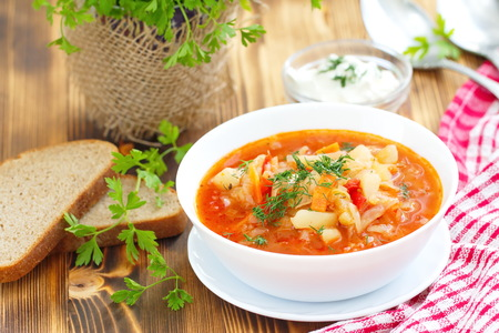 National cuisine. Traditional Russian Ukrainian vegetable borscht soup. Stock Photo