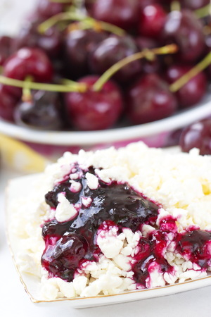 pasteurized: Cottage cheese with cherry jam and fresh berries Stock Photo