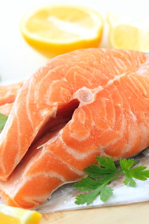 Raw salmon fillet with vegetables and lemon prepared for cooking Stock Photo