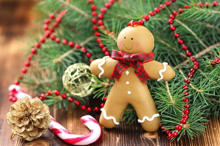 Christmas postcard with Gingerbread man in festive decoration Stock Photo