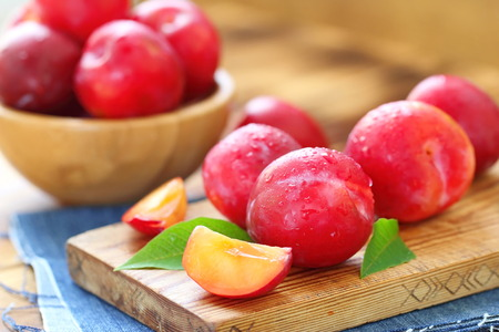 Ripe sweet plums on the table