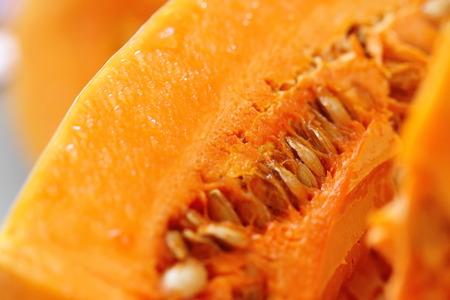 Fresh raw pumpkin closeup on wooden background Stock Photo