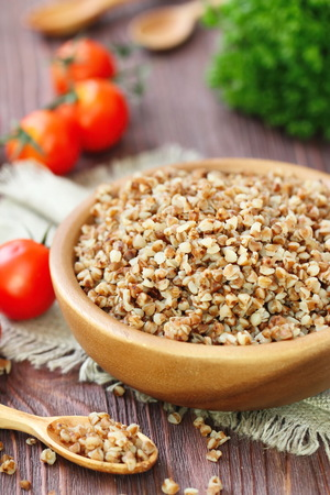 kasha: Buckwheat porrige in bowl and fresh vegetables