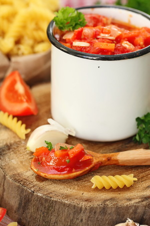 Homemade tomato sauce (jam) with ingredients for pasta Stock Photo